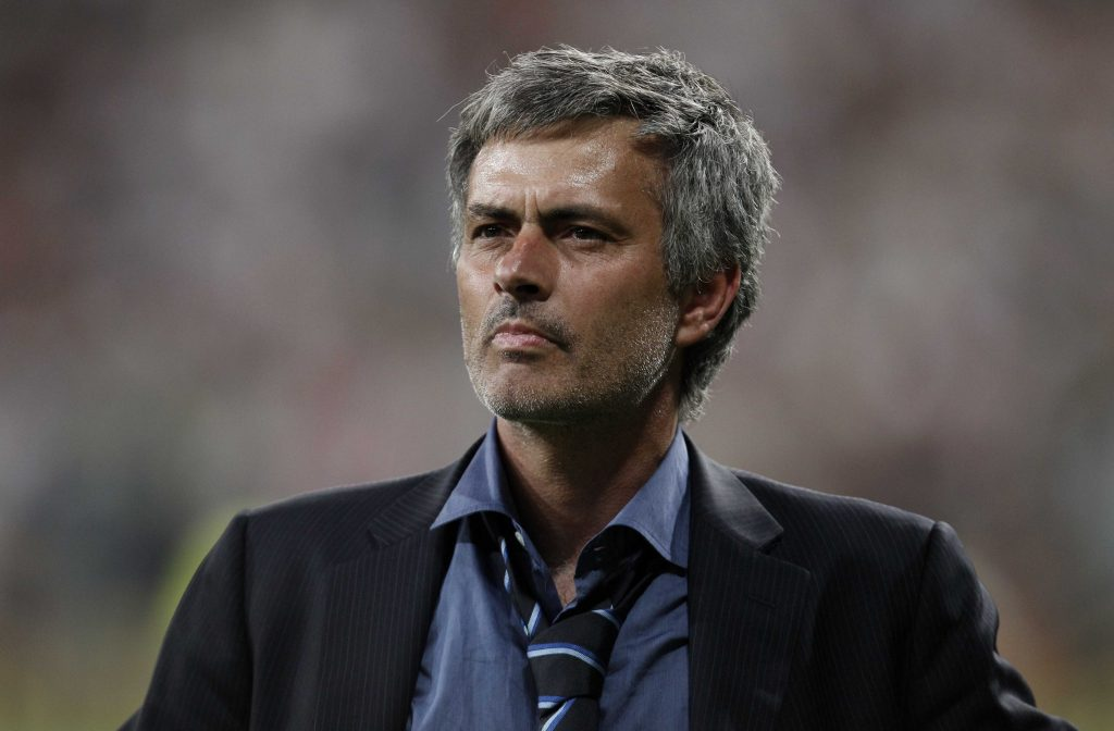 Inter Milan coach Jose Mourinho celebrates after winning the Champions League.