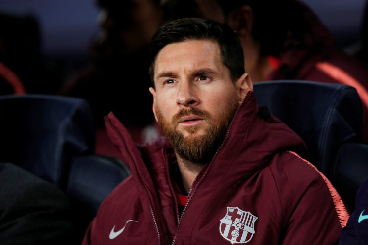 Barcelona's Lionel Messi on the substitutes bench before the match.