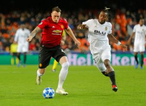 Manchester United's Phil Jones in action with Valencia's Michy Batshuayi.