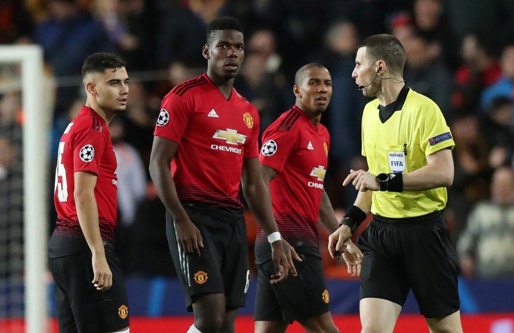 Man United's Andreas Pereira, Paul Pogba, Ashley Young and referee Georgi Kabakov look on.