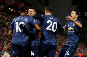 Manchester United's Jesse Lingard celebrates scoring their first goal with team mates.