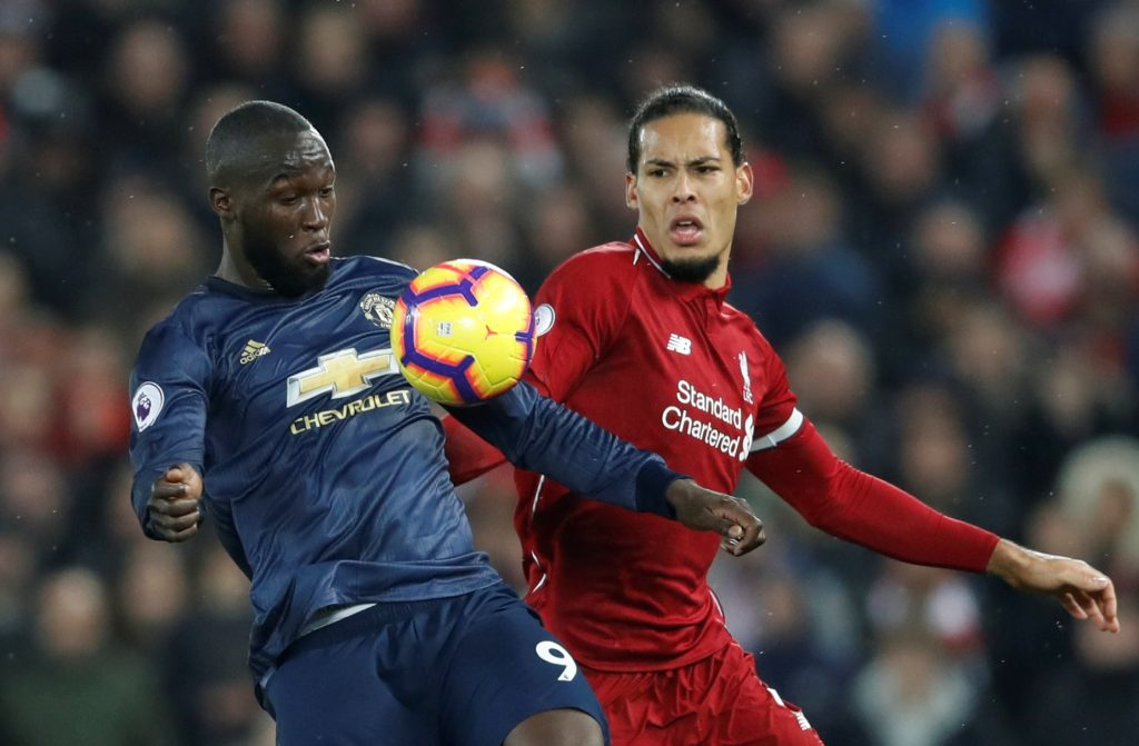 Liverpool's Virgil van Dijk in action with Manchester United's Romelu Lukaku.