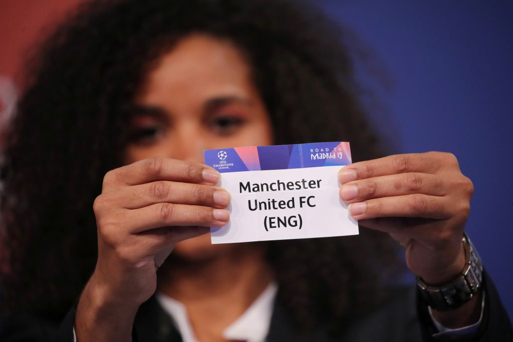 UEFA Champions League ambassador Laura Georges draws Manchester United.