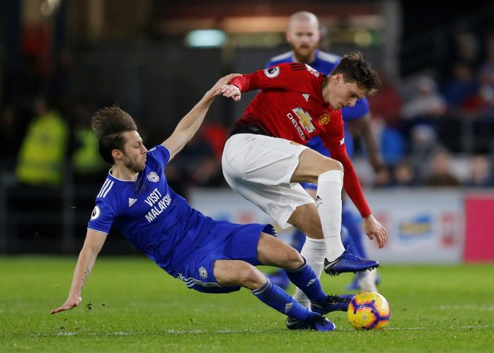 Manchester United's Victor Lindelof in action with Cardiff City's Harry Arter.