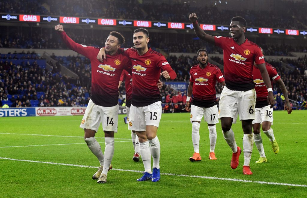 Manchester United's Jesse Lingard celebrates scoring their fifth goal with team mates.