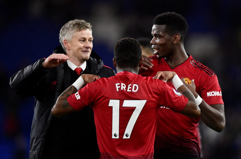 Manchester United's Paul Pogba and Fred celebrate after the match with interim manager Ole Gunnar Solskjaer.