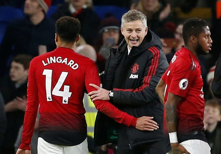 Man Utd interim manager Ole Gunnar Solskjaer celebrates after the match with Jesse Lingard.