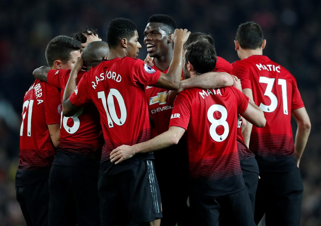 Manchester United's Paul Pogba celebrates scoring their third goal with team mates.
