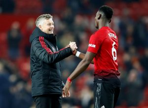 Manchester United's Paul Pogba and interim manager Ole Gunnar Solskjaer.
