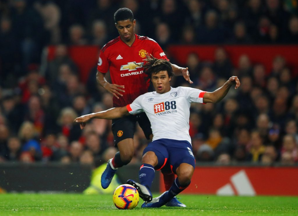 Bournemouth's Nathan Ake in action with Manchester United's Marcus Rashford.