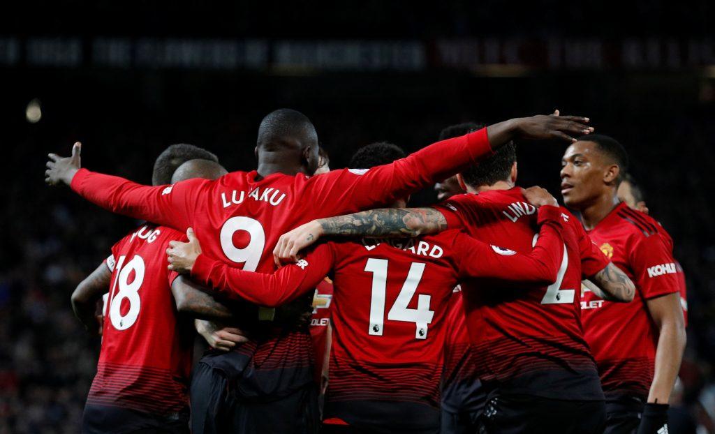 Manchester United's Romelu Lukaku celebrates scoring their fourth goal with team mates.