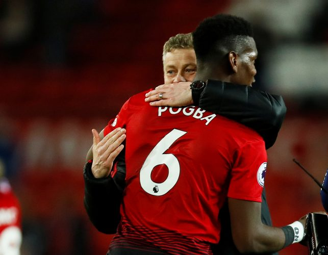 Man Utd interim manager Ole Gunnar Solskjaer celebrates with Paul Pogba after the match.