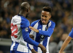 FC Porto's Eder Militao celebrates scoring their first goal with teammate Danilo Pereira.