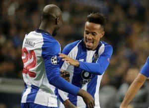 FC Porto's Eder Militao celebrates scoring their first goal with teammate Danilo Pereira.