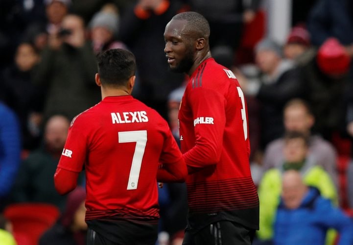 Manchester United's Romelu Lukaku celebrates with Alexis Sanchez after scoring their second goal.