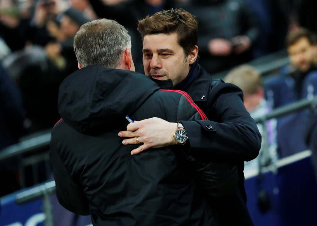 Mauricio Pochettino embraces MUFC interim manager Ole Gunnar Solskjaer before the match.