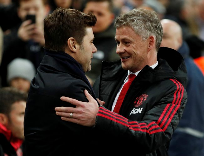 Manchester United interim manager Ole Gunnar Solskjaer shakes hands with Tottenham manager Mauricio Pochettino.