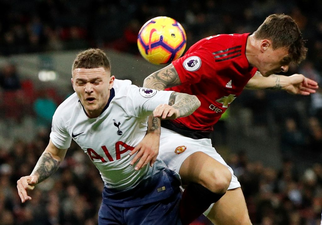 Tottenham's Kieran Trippier in action with Manchester United's Victor Lindelof.