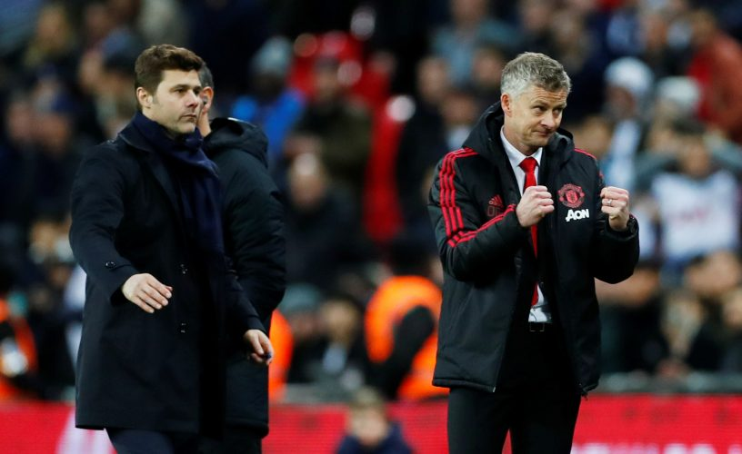 Ole Gunnar Solskjaer reacts at the end of the match as Mauricio Pochettino looks on.