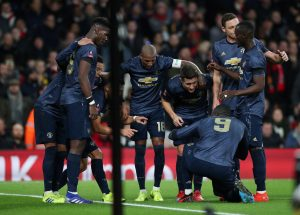 Manchester United's Alexis Sanchez celebrates scoring their first goal with team mates.