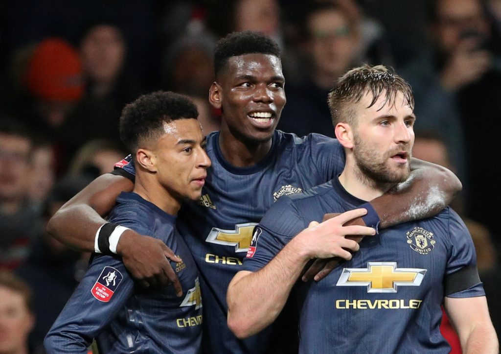 Manchester United's Jesse Lingard celebrates scoring their second goal with Paul Pogba and Luke Shaw.