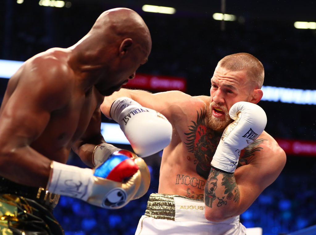 Conor McGregor moves in with a hit against Floyd Mayweather Jr.