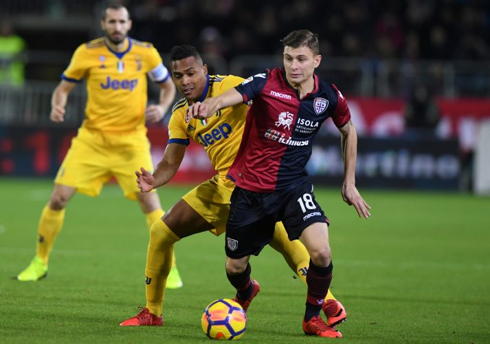 Cagliari's Nicolo Barella in action with Juventus' Alex Sandro.