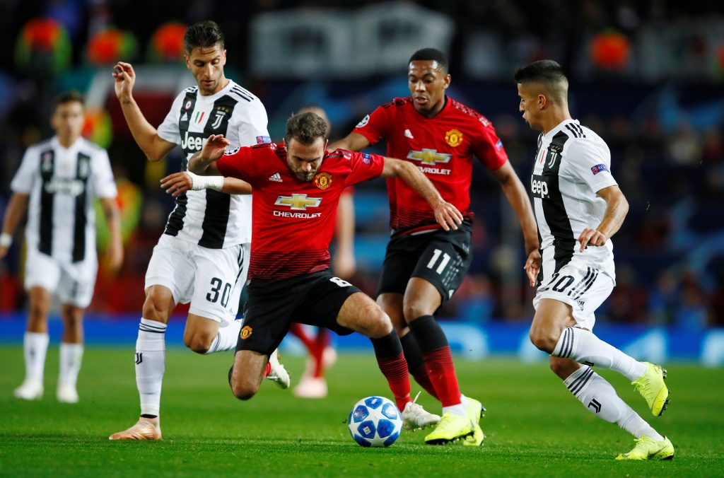 Juan Mata and Anthony Martial in action with Juventus' Joao Cancelo and Rodrigo Bentancur.