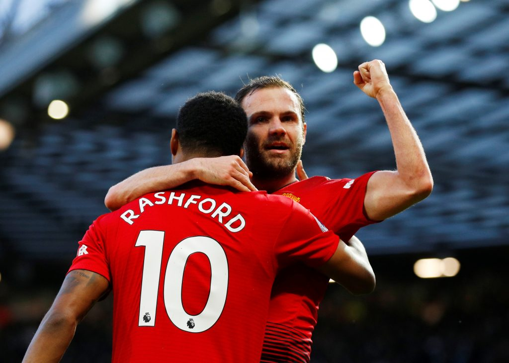 Manchester United's Juan Mata celebrates scoring their second goal with Marcus Rashford.