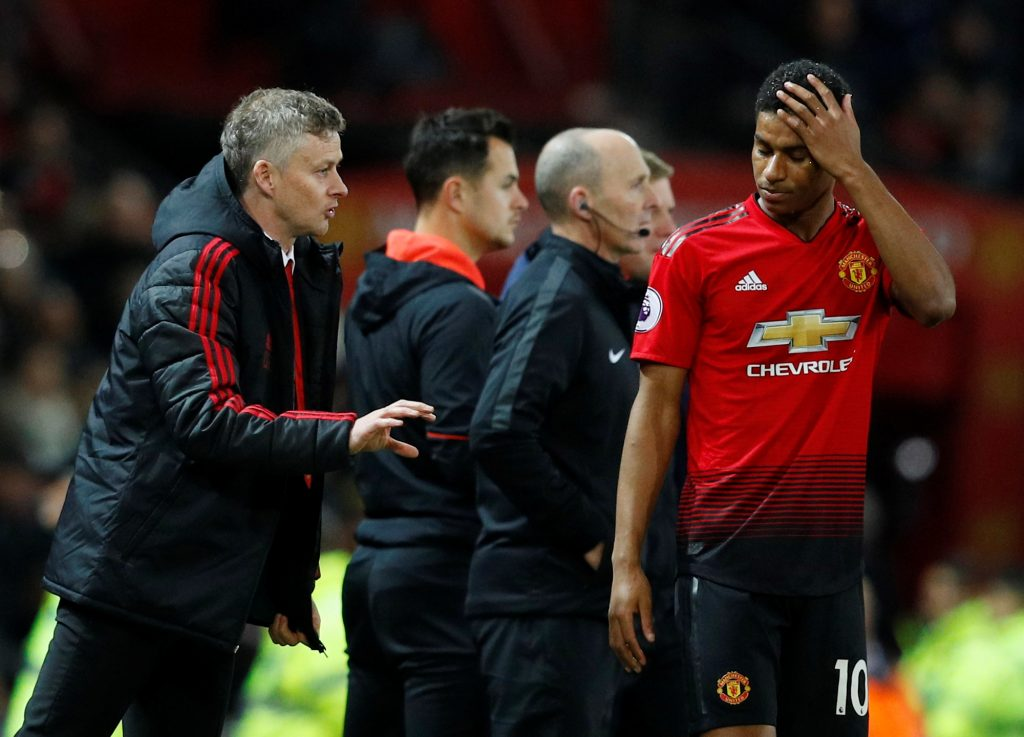 Ole Gunnar Solskjaer gives instructions to Marcus Rashford.