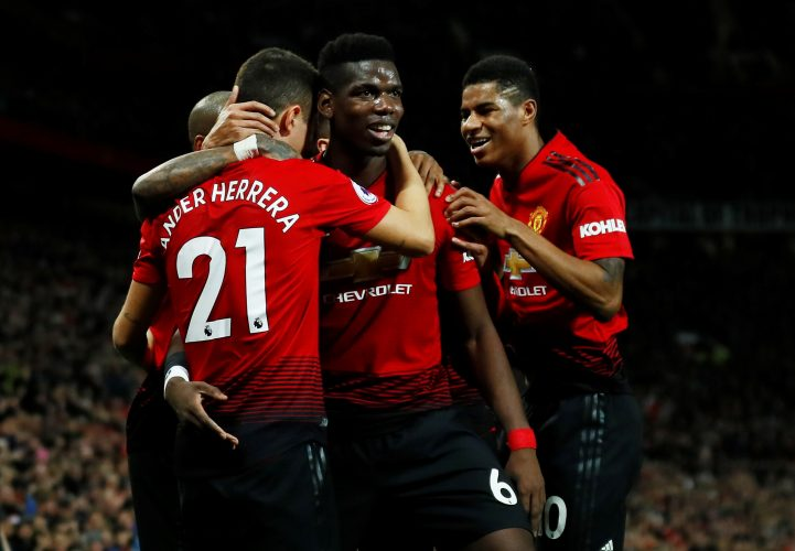 Manchester United's Paul Pogba celebrates with Ander Herrera and Marcus Rashford after scoring their second goal.