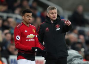 Jesse Lingard receives instructions from Ole Gunnar Solskjaer before being substituted on.