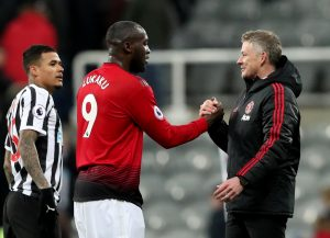 Man Utd interim manager Ole Gunnar Solskjaer shakes hands with Romelu Lukaku at the end of the match.