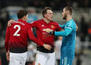 Phil Jones celebrates with David de Gea and Victor Lindelof at the end of the match.