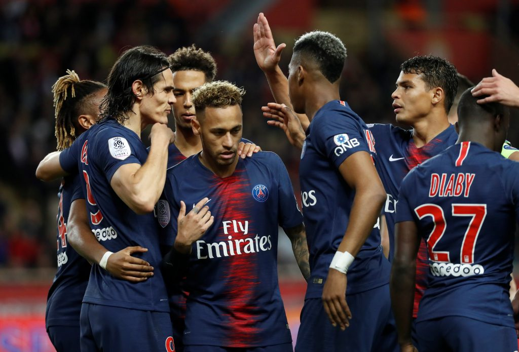 PSG's Edinson Cavani celebrates scoring their third goal and completing his hat-trick with Neymar and team mates.