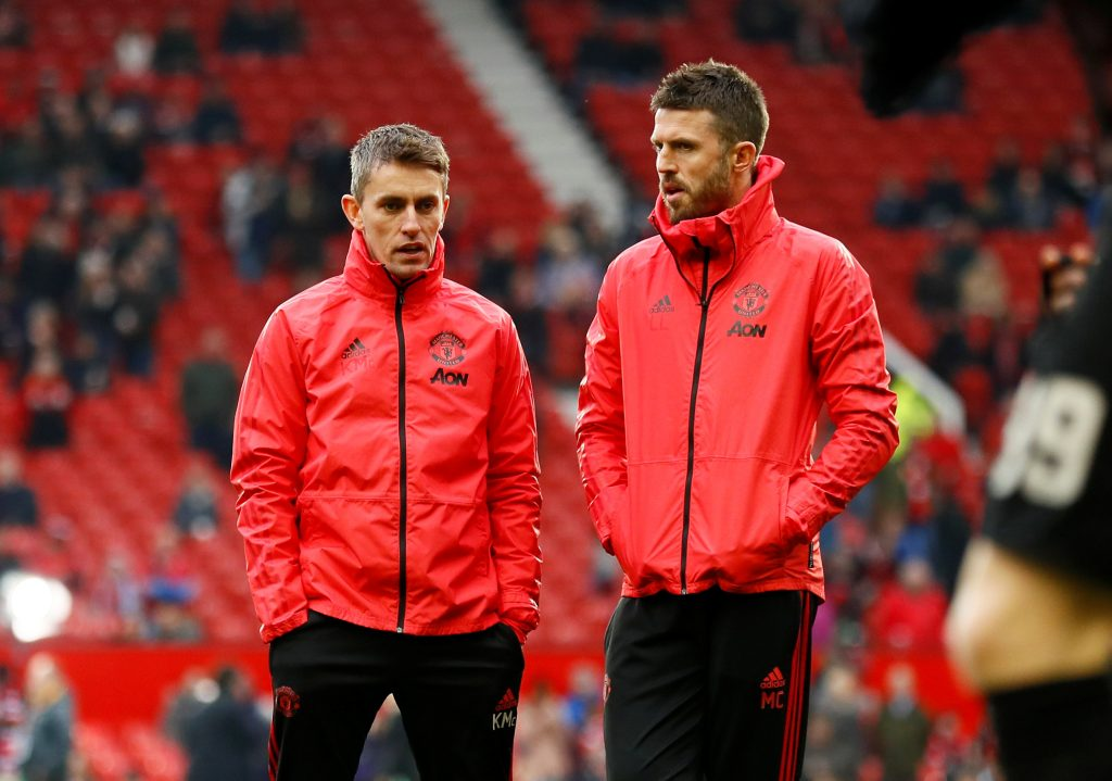 Manchester United assistant coaches Kieran McKenna and Michael Carrick during the warm up before the match.