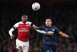 Arsenal's Ainsley Maitland-Niles in action with Man United's Alexis Sanchez.