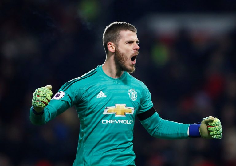 Manchester United's David de Gea celebrates after Victor Lindelof scores their second goal.