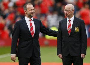 """Sir Bobby Charlton and Executive Vice Chairman Ed Woodward on the pitch as the newly renamed South Stand """"Sir Bobby Charlton stand"""" is unveiled to commemorate the 60 year anniversary of his debut for Manchester United."""