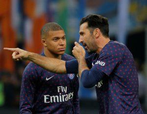 PSG's Gianluigi Buffon and Kylian Mbappe before the match.