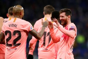 Barcelona's Lionel Messi celebrates scoring their first goal with Arturo Vidal.