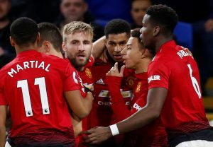 Manchester United's Marcus Rashford celebrates scoring their first goal with Paul Pogba, Anthony Martial, Jesse Lingard, Luke Shaw and team mates.