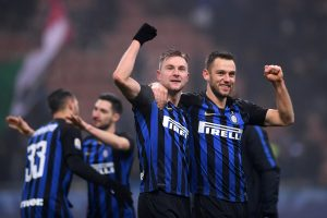 Inter Milan's Milan Skriniar celebrates with Stefan de Vrij after the match.