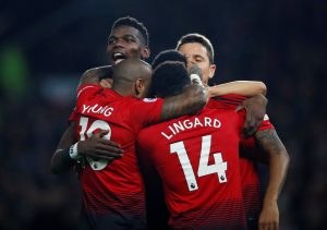 Manchester United's Paul Pogba celebrates with team mates after scoring their first goal.