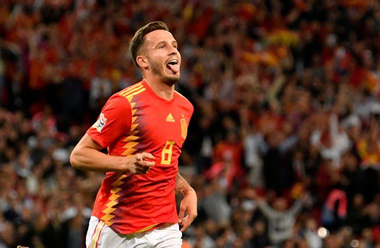 Spain's Saul Niguez celebrates scoring their first goal.