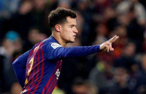 Barcelona's Philippe Coutinho celebrates scoring their third goal.