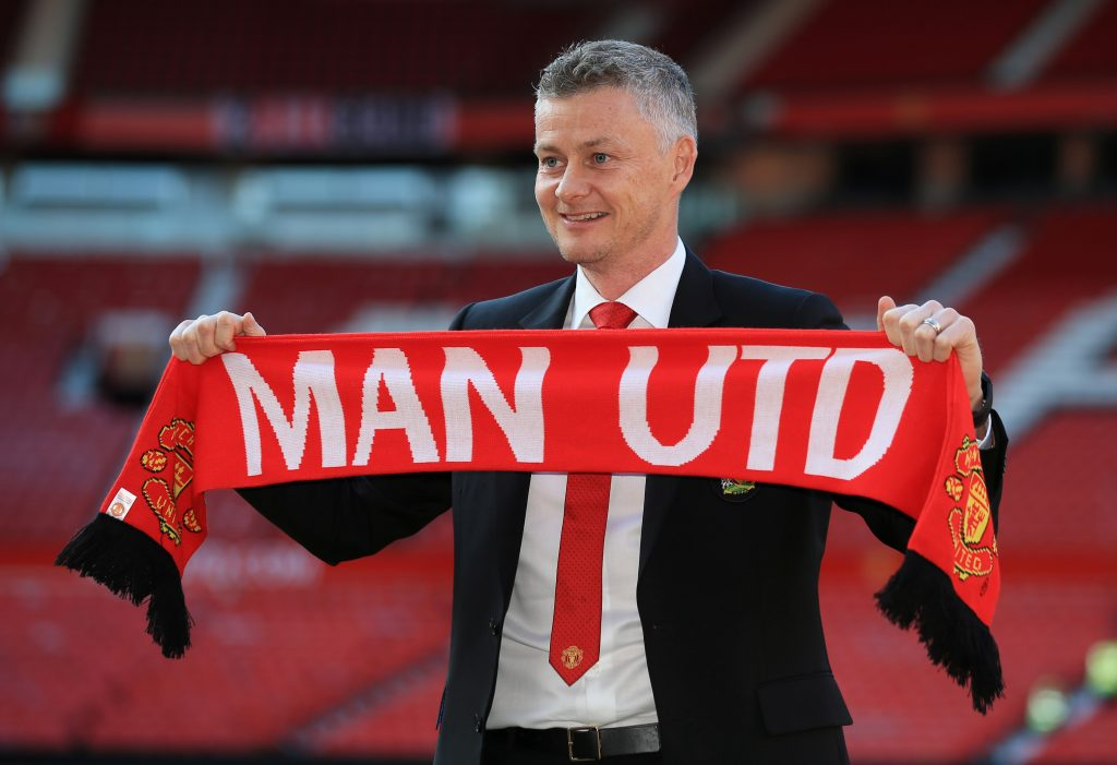 910cb60b8 OFFICIAL: Manchester United Announce First Signing Under Solskjaer · Manchester  United manager Ole Gunnar Solskjaer poses with a scarf on the pitch.