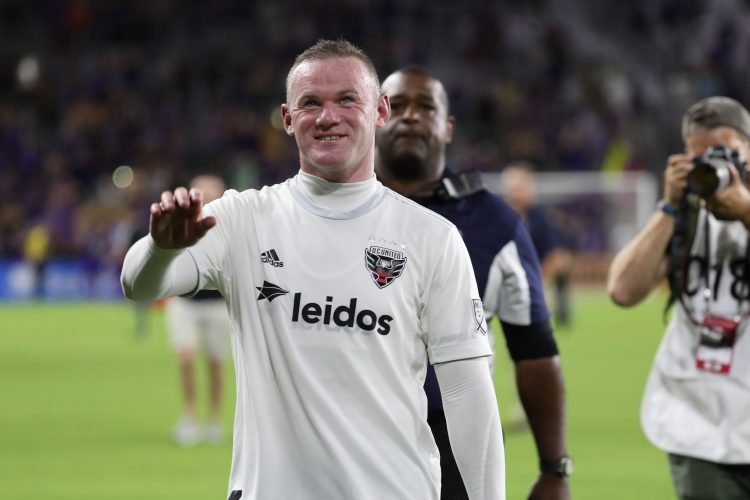 D.C. United forward Wayne Rooney (9) celebrates and smiles as they beat the Orlando City SC.
