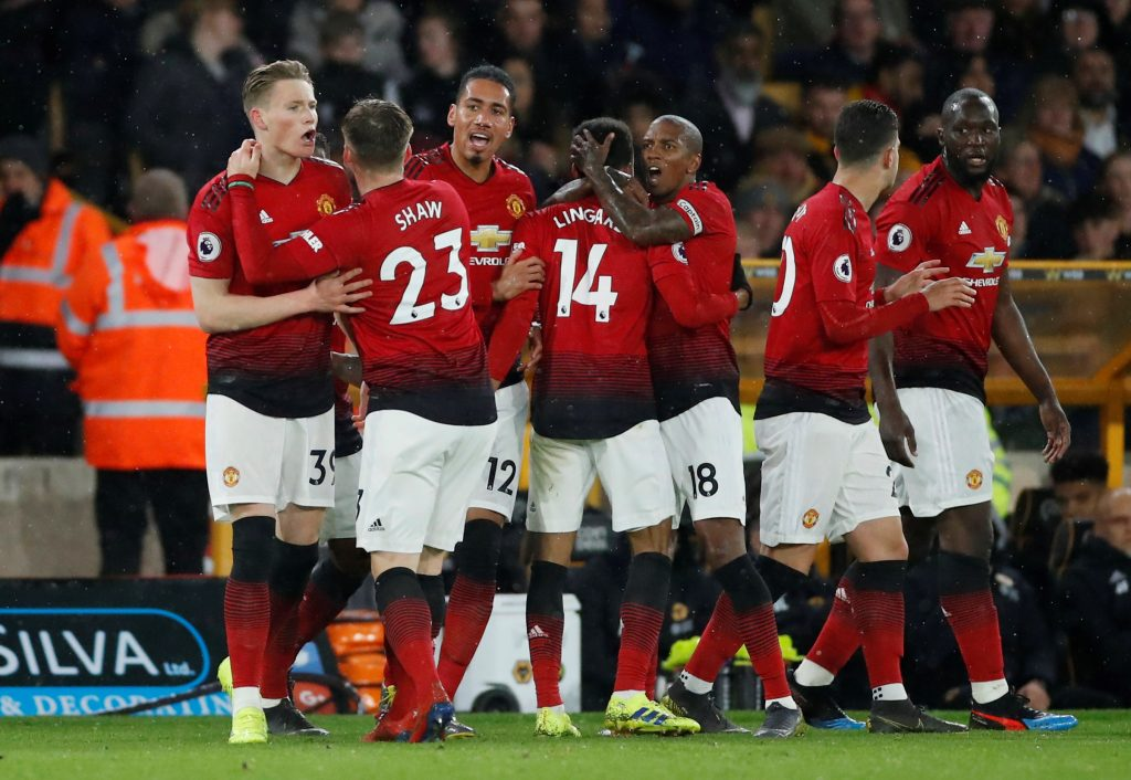 Man Utd's Scott McTominay celebrates scoring their first goal with team mates.
