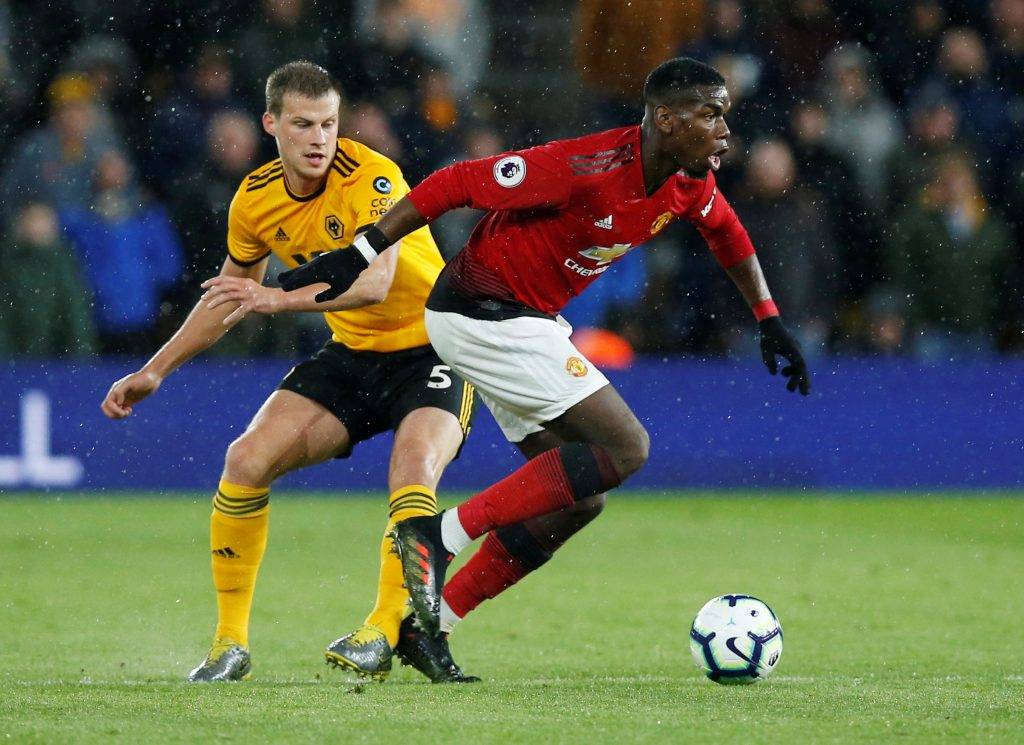 Wolves' Ryan Bennett in action with Manchester United's Paul Pogba.